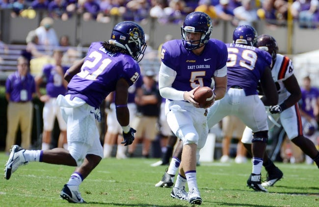 Sep 14, 2013; Greenville, NC, USA;  East Carolina Pirates quarterback Shane Carden (5) hands off to running back Vintavious Cooper (21) during the first half against the Virginia Tech Hokies at Dowdy-Ficklen Stadium. Mandatory Credit: Rob Kinnan-USA TODAY Sports