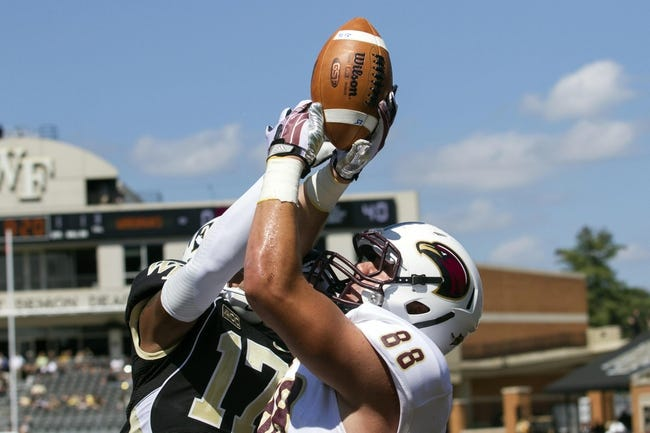 Sep 14, 2013; Winston-Salem, NC, USA; Wake Forest Demon Deacons safety A.J. Marshall (17) knocks a pass away from Louisiana Monroe Warhawks tight end Harley Scioneaux (88) during the first quarter at BB&T Field. Mandatory Credit: Jeremy Brevard-USA TODAY Sports