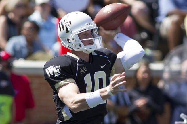 Sep 14, 2013; Winston-Salem, NC, USA; Wake Forest Demon Deacons quarterback Tanner Price (10) passes the ball during the first quarter against the Louisiana Monroe Warhawks at BB&T Field. Mandatory Credit: Jeremy Brevard-USA TODAY Sports
