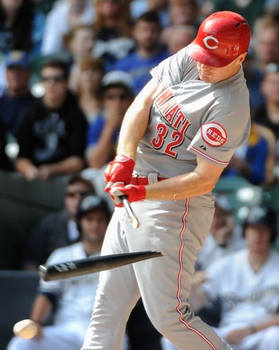 Sep 14, 2013; Milwaukee, WI, USA; Cincinnati Reds right fielder Jay Bruce breaks his bat while grounding out in the fourth inning during the game against the Milwaukee Brewers at Miller Park. Mandatory Credit: Benny Sieu-USA TODAY Sports