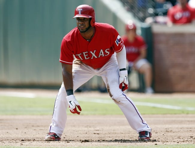 Sep 14, 2013; Arlington, TX, USA; Texas Rangers shortstop Elvis Andrus (1) takes a lead off first base against the Oakland Athletics during the first inning of a baseball game at Rangers Ballpark in Arlington. Mandatory Credit: Jim Cowsert-USA TODAY Sports