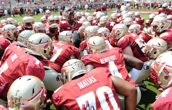 Sep 14, 2013; Tallahassee, FL, USA;  Florida State Seminoles players huddle and get ready before the start of the game against the Nevada Wolf Pack at Doak Campbell Stadium. Mandatory Credit: Melina Vastola-USA TODAY Sports