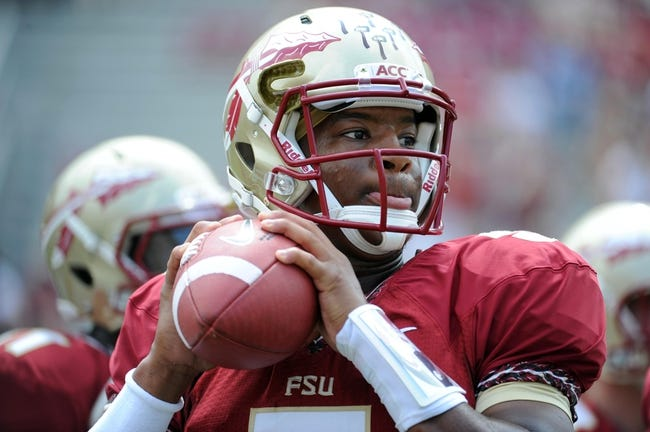 Sep 14, 2013; Tallahassee, FL, USA; Florida State Seminoles quarterback Jameis Winston (5) warms up before the start of the game against the Nevada Wolf Pack at Doak Campbell Stadium. Mandatory Credit: Melina Vastola-USA TODAY Sports