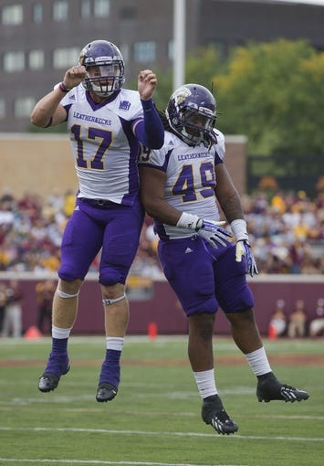 Sep 14, 2013; Minneapolis, MN, USA; Western Illinois Leathernecks linebacker Kevin Kintzel (17) celebrates with Western Illinois Leathernecks defensive lineman Jacoby Sessions (49) after recovering a fumble in the third quarter against the Minnesota Golden Gophers at TCF Bank Stadium. The Gophers won 29-12. Mandatory Credit: Jesse Johnson-USA TODAY Sports