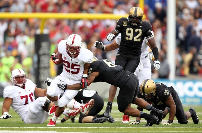 Sep 14, 2013; West Point, NY, USA; Stanford Cardinal running back Tyler Gaffney (25) rushes past Army Black Knights defensive lineman Mike Ugenyi (92) at Michie Stadium. Mandatory Credit: Danny Wild-USA TODAY Sports