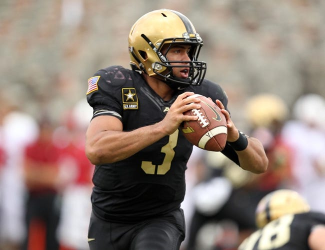 Sep 14, 2013; West Point, NY, USA; Army Black Knights quarterback Angel Santiago (3) looks to pass against the Stanford Cardinal at Michie Stadium. Mandatory Credit: Danny Wild-USA TODAY Sports