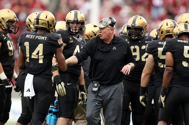 Sep 14, 2013; West Point, NY, USA; Army Black Knights head coach Rich Ellerson talks to his defense during the second half against the Stanford Cardinal at Michie Stadium. Mandatory Credit: Danny Wild-USA TODAY Sports