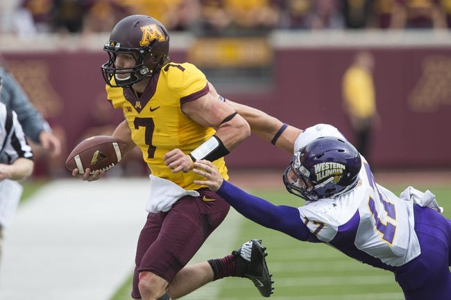 Sep 14, 2013; Minneapolis, MN, USA; Minnesota Golden Gophers quarterback Mitch Leidner (7) runs with the ball past Western Illinois Leathernecks linebacker Kevin Kintzel (17) in the fourth quarter at TCF Bank Stadium. The Gophers won 29-12. Mandatory Credit: Jesse Johnson-USA TODAY Sports