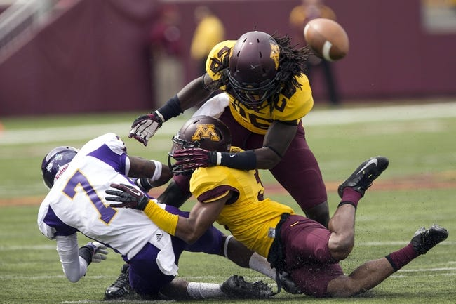 Sep 14, 2013; Minneapolis, MN, USA; Minnesota Golden Gophers defensive back Martez Shabazz (3) and linebacker De'Vondre Campbell (26) knock the ball away from Western Illinois Leathernecks wide receiver Lance Lenior Jr. (7) in the third quarter at TCF Bank Stadium. The Gophers won 29-12. Mandatory Credit: Jesse Johnson-USA TODAY Sports