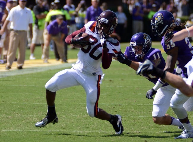 Sep 14, 2013; Greenville, NC, USA;  Virginia Tech Hokies receiver Demitri Knowles is pulled down after a reception by East Carolina Pirates defensive back Damon Magazu (11) during the second half at Dowdy-Ficklen Stadium.  Virginia Tech won 15-10. Mandatory Credit: Rob Kinnan-USA TODAY Sports