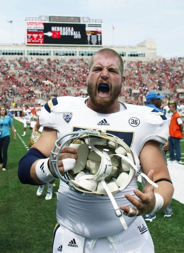 Sep 14, 2013; Lincoln, NE, USA; UCLA Bruins Carl Hulick (57) yells as he leaves the field after defeating the Nebraska Cornhuskers at Memorial Stadium. UCLA won 41-21. Mandatory Credit: Bruce Thorson-USA TODAY Sports