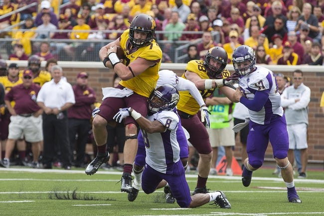 Sep 14, 2013; Minneapolis, MN, USA; Minnesota Golden Gophers quarterback Mitch Leidner (7) runs with the ball as he gets tackled by Western Illinois Leathernecks defensive back Antoine Ford (8) in the fourth quarter at TCF Bank Stadium. The Gophers won 29-12. Mandatory Credit: Jesse Johnson-USA TODAY Sports