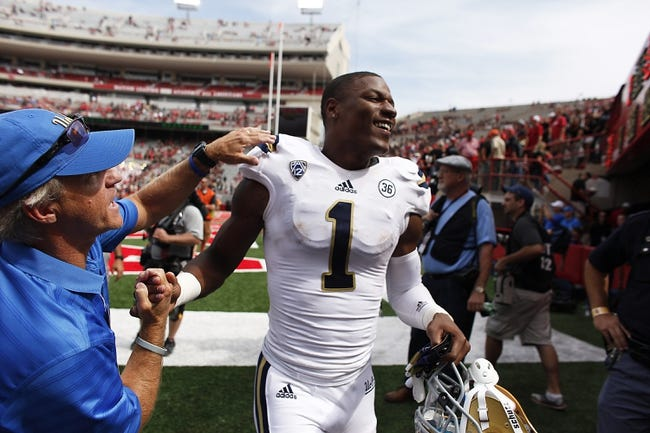Sep 14, 2013; Lincoln, NE, USA; UCLA Bruins wide receiver Shaquelle Evans (1) is congratulated after defeating the Nebraska Cornhuskers at Memorial Stadium. UCLA won 41-21. Mandatory Credit: Bruce Thorson-USA TODAY Sports