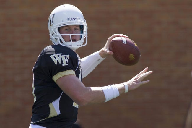 Sep 14, 2013; Winston-Salem, NC, USA; Wake Forest Demon Deacons quarterback Tanner Price (10) throws a pass during the fourth quarter against the Louisiana Monroe Warhawks at BB&T Field. Louisiana Monroe Warhawks defeated the Wake Forest Demon Deacons 21-19. Mandatory Credit: Jeremy Brevard-USA TODAY Sports