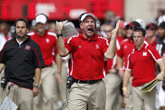 Sep 14, 2013; Lincoln, NE, USA; Nebraska Cornhuskers head coach Bo Pelini tries to call a timeout against the UCLA Bruins in the fourth quarter at Memorial Stadium. UCLA won 41-21. Mandatory Credit: Bruce Thorson-USA TODAY Sports