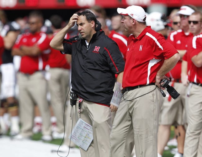 Sep 14, 2013; Lincoln, NE, USA; Nebraska Cornhuskers defensive coordinator John Papuchis and head coach Bo Pelini watch their team during the final minutes of the game against the UCLA Bruins in the fourth quarter at Memorial Stadium. UCLA won 41-21. Mandatory Credit: Bruce Thorson-USA TODAY Sports