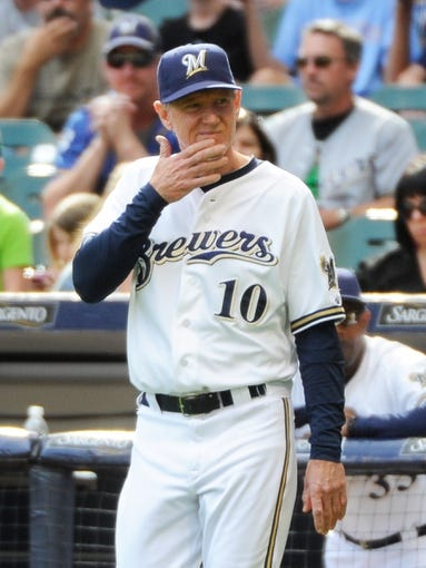 Sep 14, 2013; Milwaukee, WI, USA; Milwaukee Brewers manager Ron Roenicke makes a pitching change in the ninth inning during the game against the Cincinnati Reds at Miller Park. Mandatory Credit: Benny Sieu-USA TODAY Sports