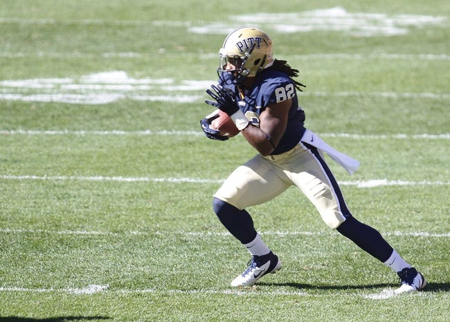 Sep 14, 2013; Pittsburgh, PA, USA; Pittsburgh Panthers tight end Manasseh Garner (82) runs after a pass reception against the New Mexico Lobos during the fourth quarter at Heinz Field. The Pittsburgh Panthers won 49-27. Mandatory Credit: Charles LeClaire-USA TODAY Sports