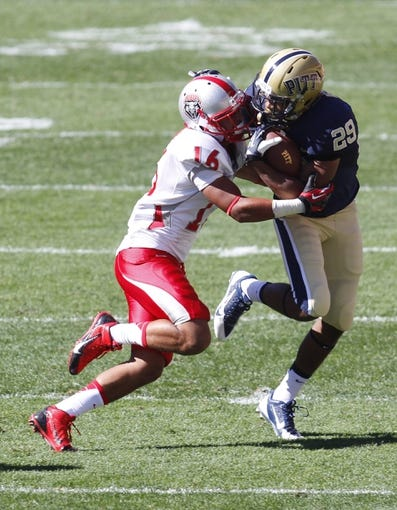 Sep 14, 2013; Pittsburgh, PA, USA; Pittsburgh Panthers running back Rachid Ibrahim (29) carries the ball as New Mexico Lobos cornerback Isaiah Brown (16) defends during the fourth quarter against at Heinz Field. The Pittsburgh Panthers won 49-27. Mandatory Credit: Charles LeClaire-USA TODAY Sports