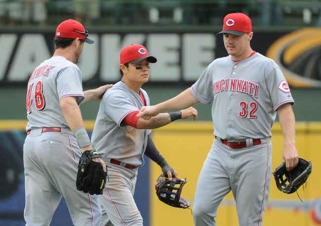 Sep 14, 2013; Milwaukee, WI, USA;  Cincinnati Reds left fielder Ryan Ludwick (left), center fielder Shin-Soo Choo (center) and right fielder Jay Bruce celebrate after the Reds beat the Milwaukee Brewers 7-3 at Miller Park. Mandatory Credit: Benny Sieu-USA TODAY Sports