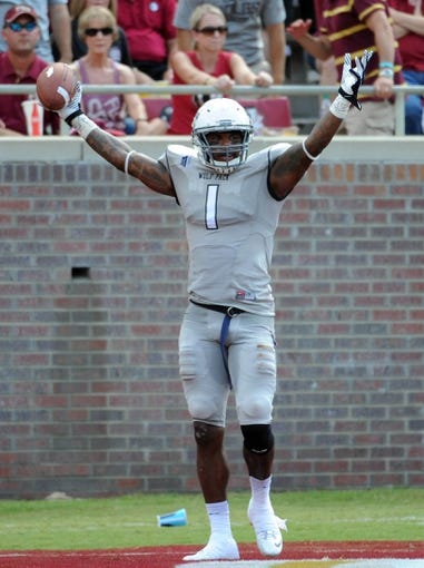 Sep 14, 2013; Tallahassee, FL, USA; Nevada Wolf Pack wide receiver Brandon Wimberly (1) celebrates a touchdown catch during the first half of the game against the Florida State Seminoles at Doak Campbell Stadium. Mandatory Credit: Melina Vastola-USA TODAY Sports