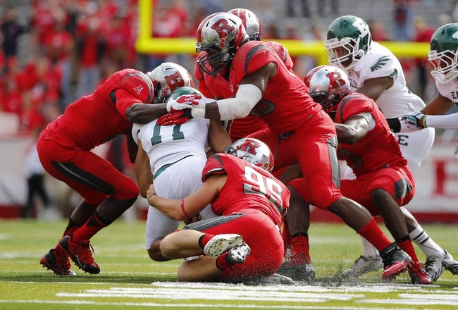 Sep 14, 2013; Piscataway, NJ, USA;  Eastern Michigan Eagles wide receiver Tyler Allen (11) is wrapped up by Rutgers Scarlet Knights during the second half at High Points Solutions Stadium. Rutgers Scarlet Knights defeat Eastern Michigan Eagles 28-10. Mandatory Credit: Jim O'Connor-USA TODAY Sports
