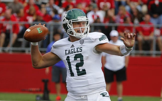 Sep 14, 2013; Piscataway, NJ, USA;  Eastern Michigan Eagles quarterback Tyler Benz (12) unloads pass during the second half against the Rutgers Scarlet Knights at High Points Solutions Stadium. Rutgers Scarlet Knights defeat Eastern Michigan Eagles 28-10. Mandatory Credit: Jim O'Connor-USA TODAY Sports