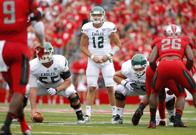 Sep 14, 2013; Piscataway, NJ, USA;  Eastern Michigan Eagles quarterback Tyler Benz (12) calls signals during the second half against the Rutgers Scarlet Knights at High Points Solutions Stadium. Rutgers Scarlet Knights defeat Eastern Michigan Eagles 28-10. Mandatory Credit: Jim O'Connor-USA TODAY Sports