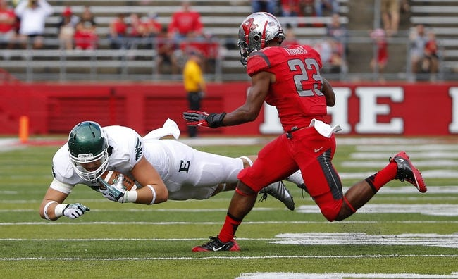 Sep 14, 2013; Piscataway, NJ, USA;  Eastern Michigan Eagles tight end Cole Gardner (84) makes reception during the second half as he is covered by Rutgers Scarlet Knights defensive back Ian Thomas (23) at High Points Solutions Stadium. Rutgers Scarlet Knights defeat Eastern Michigan Eagles 28-10. Mandatory Credit: Jim O'Connor-USA TODAY Sports