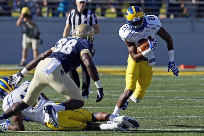 Sep 14, 2013; Annapolis, MD, USA; Delaware Blue Hens wide receiver Stephen Clark (21) runs towards Navy Midshipmen linebacker Wiliam Tuider (38) following his catch at Navy Marine Corps Memorial Stadium. Mandatory Credit: Mitch Stringer-USA TODAY Sports