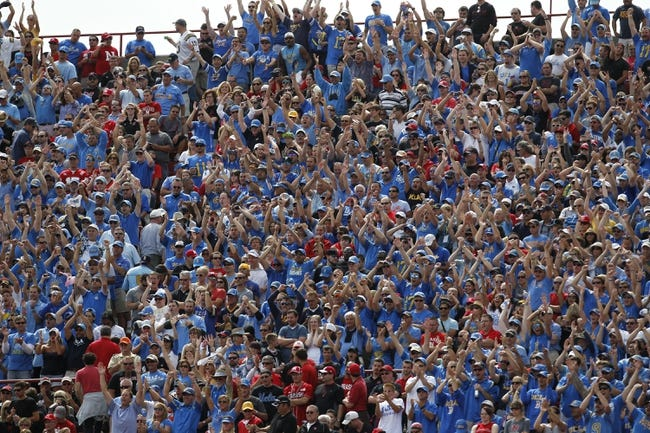 Sep 14, 2013; Lincoln, NE, USA; UCLA Bruins fans cheer after UCLA scored a touchdown against the Nebraska Cornhuskers in the third quarter at Memorial Stadium. UCLA won 41-21. Mandatory Credit: Bruce Thorson-USA TODAY Sports