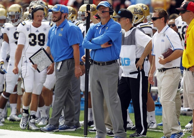 Sep 14, 2013; Lincoln, NE, USA; UCLA Bruins head coach Jim Mora looks at the scoreboard during the game against the Nebraska Cornhuskers in the third quarter at Memorial Stadium. UCLA won 41-21. Mandatory Credit: Bruce Thorson-USA TODAY Sports