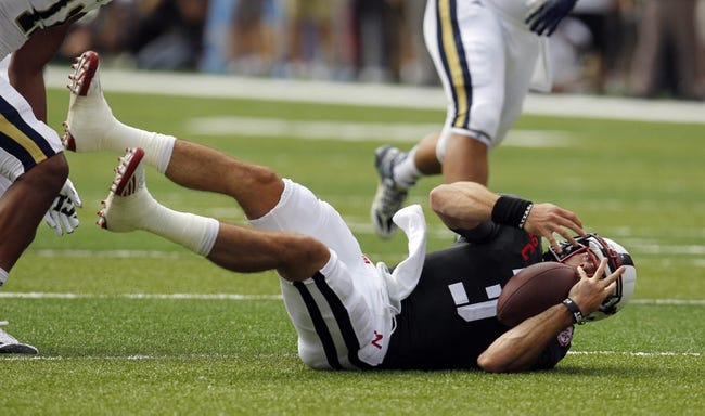 Sep 14, 2013; Lincoln, NE, USA; Nebraska Cornhuskers quarterback Taylor Martinez (3) recovers his own fumble against the UCLA Bruins in the second quarter at Memorial Stadium. UCLA won 41-21. Mandatory Credit: Bruce Thorson-USA TODAY Sports