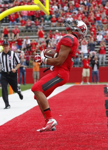 Sep 14, 2013; Piscataway, NJ, USA;  Rutgers Scarlet Knights running back Paul James (34) celebrates first quarter touch down against the Eastern Michigan Eagles at High Points Solutions Stadium. Mandatory Credit: Jim O'Connor-USA TODAY Sports