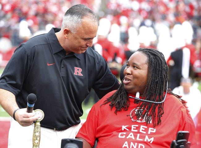 Sep 14, 2013; Piscataway, NJ, USA;  Rutgers Scarlet Knights head coach Kyle Flood and Eric LeGrand during halftime ceremony retiring his number 52 at High Points Solutions Stadium. Mandatory Credit: Jim O'Connor-USA TODAY Sports