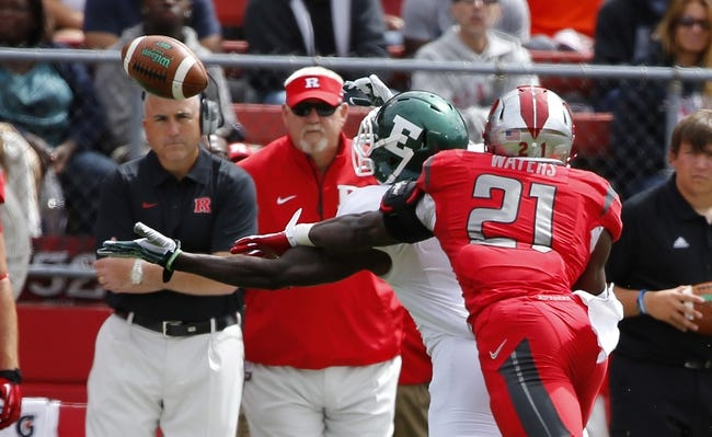 Sep 14, 2013; Piscataway, NJ, USA;  Rutgers Scarlet Knights defensive back Lorenzo Waters (21) breaks up Eastern Michigan Eagles pass as head coach Kyle Flood looks on during the first half at High Points Solutions Stadium. Mandatory Credit: Jim O'Connor-USA TODAY Sports