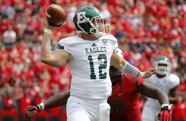 Sep 14, 2013; Piscataway, NJ, USA;  Eastern Michigan Eagles quarterback Tyler Benz (12) gets pass off as he is pressured by Rutgers Scarlet Knights defensive lineman Jamil Merrell (92) during the first half at High Points Solutions Stadium. Mandatory Credit: Jim O'Connor-USA TODAY Sports