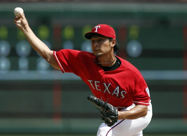 Sep 14, 2013; Arlington, TX, USA; Texas Rangers starting pitcher Yu Darvish (11) throws to the Oakland Athletics during the seventh inning of a baseball game at Rangers Ballpark in Arlington. The Athletics won 1-0. Mandatory Credit: Jim Cowsert-USA TODAY Sports