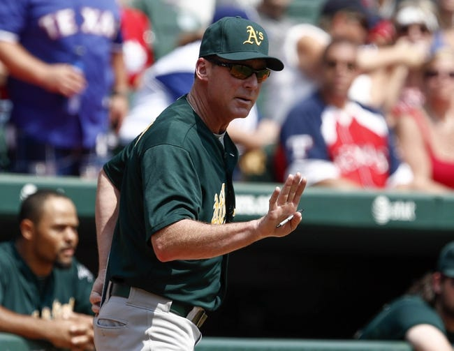 Sep 14, 2013; Arlington, TX, USA; Oakland Athletics manager Bob Melvin (6) motions to umpire Joe West (not pictured) during the game against the Texas Rangers in the sixth inning of a baseball game at Rangers Ballpark in Arlington. The Athletics won 1-0. Mandatory Credit: Jim Cowsert-USA TODAY Sports