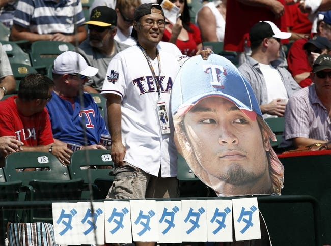 Sep 14, 2013; Arlington, TX, USA; A Texas Rangers fan shows support for starting pitcher Yu Darvish (not shown) during the game against the Oakland Athletics at Rangers Ballpark in Arlington. The Athletics won 1-0. Mandatory Credit: Jim Cowsert-USA TODAY Sports