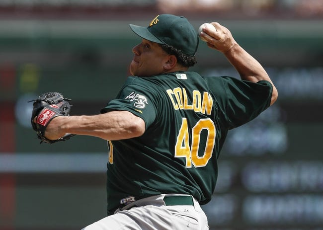 Sep 14, 2013; Arlington, TX, USA; Oakland Athletics starting pitcher Bartolo Colon (40) throws to the Texas Rangers during the seventh inning of a baseball game at Rangers Ballpark in Arlington. The Athletics won 1-0. Mandatory Credit: Jim Cowsert-USA TODAY Sports