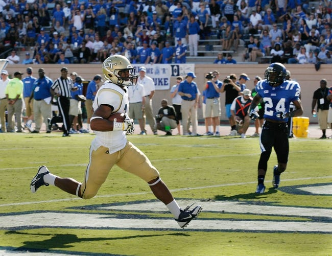 Sep 14, 2013; Durham, NC, USA; Georgia Tech Yellow Jackets wide receiver DeAndre Smelter (15) scores a touchdown against the Duke Blue Devils at Wallace Wade Stadium. Mandatory Credit: Mark Dolejs-USA TODAY Sports