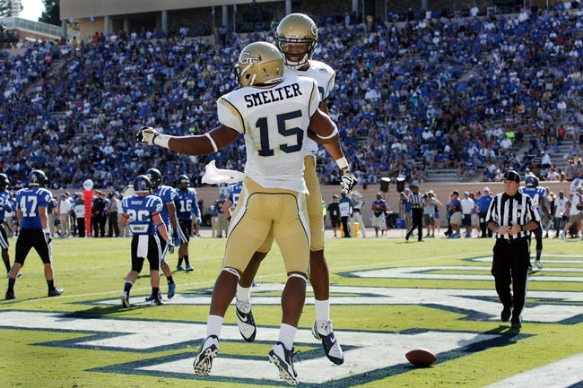 Sep 14, 2013; Durham, NC, USA; Georgia Tech Yellow Jackets wide receiver Darren Waller (88) celebrates with wide receiver DeAndre Smelter (15) after Smelter scored a touchdown against the Duke Blue Devils at Wallace Wade Stadium. Mandatory Credit: Mark Dolejs-USA TODAY Sports