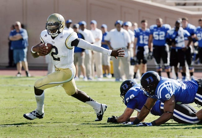 Sep 14, 2013; Durham, NC, USA; Georgia Tech Yellow Jackets quarterback Vad Lee (2) scrambles away from the Duke Blue Devils defense at Wallace Wade Stadium. Mandatory Credit: Mark Dolejs-USA TODAY Sports