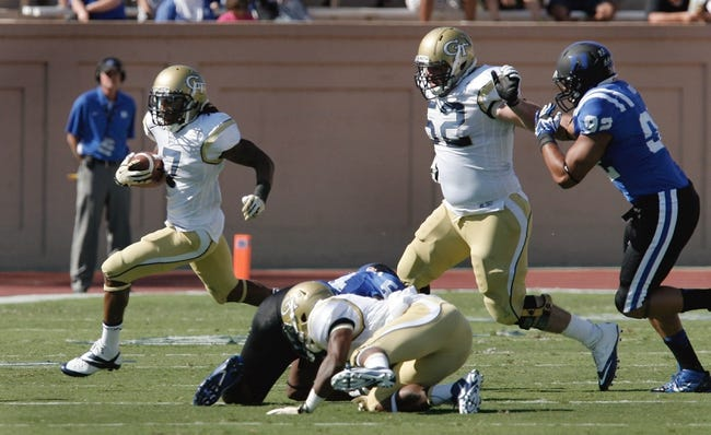 Sep 14, 2013; Durham, NC, USA; Georgia Tech Yellow Jackets running back B.J. Bostic (7) picks up yardage against the Duke Blue Devils at Wallace Wade Stadium. Mandatory Credit: Mark Dolejs-USA TODAY Sports