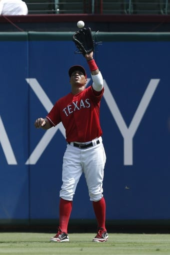 Sep 14, 2013; Arlington, TX, USA; Texas Rangers center fielder Leonys Martin (2) catches the fly ball hit by Oakland Athletics second baseman Eric Sogard (not pictured) during the eighth inning of a baseball game at Rangers Ballpark in Arlington. The Athletics won 1-0. Mandatory Credit: Jim Cowsert-USA TODAY Sports