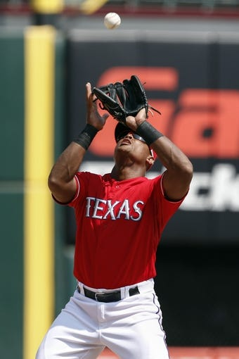 Sep 14, 2013; Arlington, TX, USA; Texas Rangers third baseman Adrian Beltre (29) catches the infield fly ball hit by Oakland Athletics center fielder Coco Crisp (not pictured) during the eighth inning of a baseball game at Rangers Ballpark in Arlington. The Athletics won 1-0. Mandatory Credit: Jim Cowsert-USA TODAY Sports