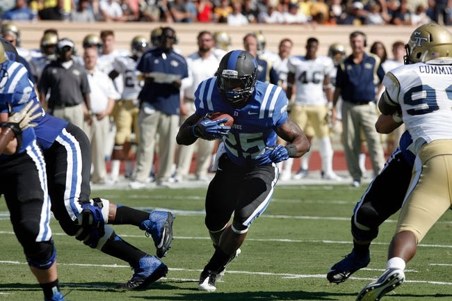 Sep 14, 2013; Durham, NC, USA; Duke Blue Devils running back Jela Duncan (25) runs the ball against the Georgia Tech Yellow Jackets at Wallace Wade Stadium. Mandatory Credit: Mark Dolejs-USA TODAY Sports