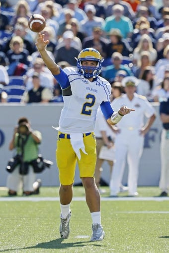 Sep 14, 2013; Annapolis, MD, USA; Delaware Blue Hens quarterback Trent Hurley (2) throws a pass against the Navy Midshipmen at Navy Marine Corps Memorial Stadium. Mandatory Credit: Mitch Stringer-USA TODAY Sports