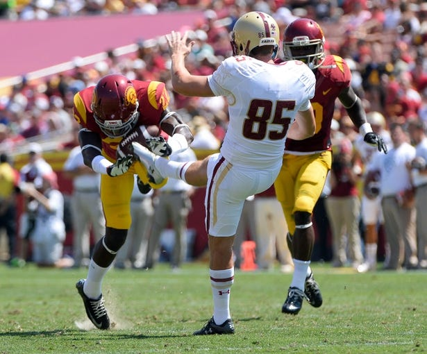 Sep 14, 2013; Los Angeles, CA, USA; USC Trojans safety Leon McQuay III (22) blocks a punt by Boston College Eagles kicker Nate Freese (85) during first half action at the Los Angeles Memorial Coliseum. The play was nullified on a penalty. The Trojans went on to a 35-7 win over the Eagles. Mandatory Credit: Robert Hanashiro-USA TODAY Sports